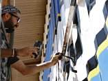 Grafitero en Kibera