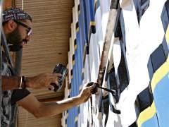 Grafiteros españoles rinden homenaje a los héroes de Kibera