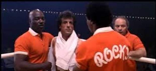 Burton and Stallone, in a scene from Rocky III