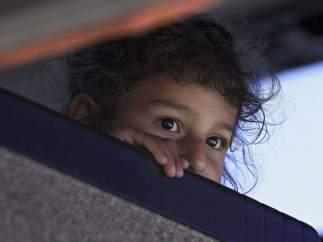 Una refugiada siria, a bordo de un autobús