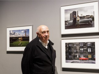 Photographer Raymond Depardon with his work, Barbican Art Gallery, London