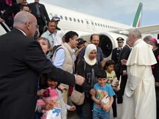 Refugiados acogidos por el papa