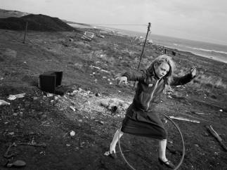 Chris Killip  - Helen and Hula-Hoop, Seacoal Beach, Lynemouth, Northumbria, UK, 1984