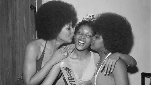 Raphael Albert - Miss Black & Beautiful Sybil McLean with fellow contestants, Hammersmith Palais, London, 1972. From the portfolio 'Black Beauty Pageants'.