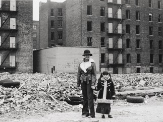 Mother and daughter pause in the ruins, which is still their home, Claremont Parkway, 1976-1982