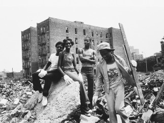 Teens clean up the rubble in order to create a neighborhood garden. 1976-1982