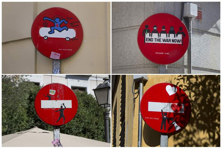 Arte 'Yipi yipi' en las señales de tráfico en Madrid. Yeah Street Art, mezcla de humor con crítica social.