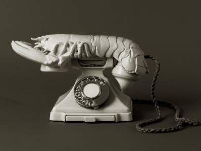 Teléfono afrodisiaco blanco
