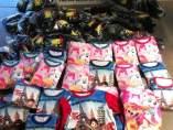 Ropa falsificada intervenda en el Mercado de Algiròs de Valencia