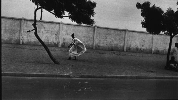 Ming Smith - Dakar Roadside with Figures, Dakar, Senegal, 1972
