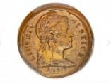 Moneda de plástico de un centavo de dólar