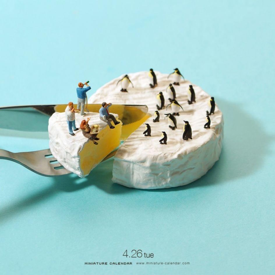 Pingüinos sobre un queso.