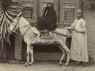 J. Pascal Sébah (1823-1886) or Jean Pascal Sébah (1872-1947) - Egyptian woman on a donkey, ca. 1880-1898
