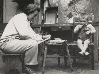 Joan Eardley seated with a small boy, sketching by Audrey Walker