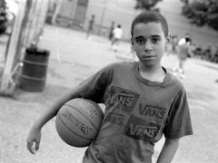 Robert Gerhardt, Young Basketball Player in the Park before Friday Prayers, Brooklyn, NY, 2011