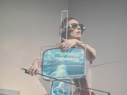 Charlotte Moorman performs Nam June Paik's TV Cello wearing TV Glasses, New York, 1971