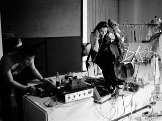 """Charlotte Moorman performs John Cage's 26'1.1499"""" for a String Player at opening celebration for Art by Telephone, Museum of Contemporary Art Chicago, October 31, 1969"""