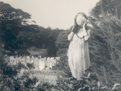 Self-portrait (with masked face and graveyard) by Claude Cahun, c.1947