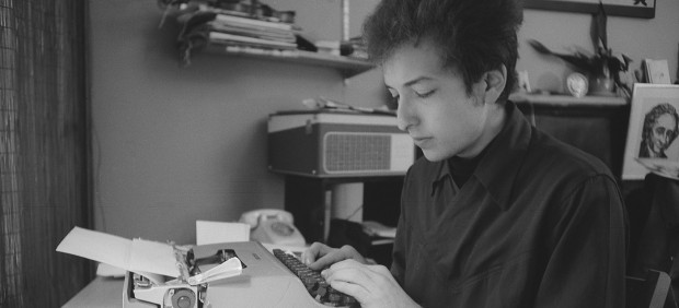 Ted Russell - Dylan at his typewriter. 161 W 4th St. 1964