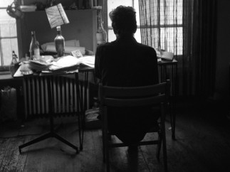 Ted Russell - Dylan at his desk. #1 161 W 4th St. 1964