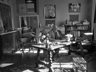 Photograph by Henri Cartier-Bresson (1908-2004) of Matisse with his collection of Kuba cloths and a Samoan tapa on the wall behind him, Villa La Rêve, Vence, 1944
