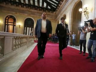El líder de ERC, O.Junqueras, y el presidente de la Generalitat, C.Puigdemont.