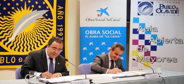 Vicente Guzmán y Rafael Herrador, durante la firma del convenio