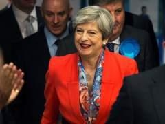 May alcanza un acuerdo con los unionistas para gobernar