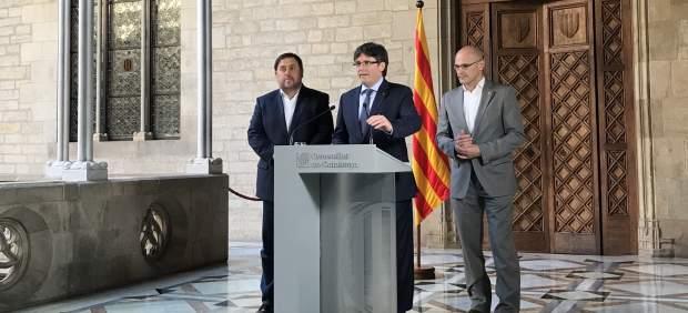 El pte. C.Puigdemont y los consellers O.Junqueras y R.Romeva.