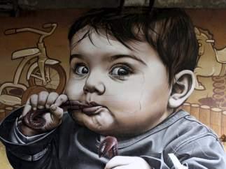 Los murales de Smug, el artista urbano que decora el mundo con sus retratos