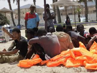 Inmigrantes en la playa