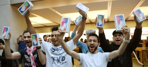 Celebrating that they have an iPhone X
