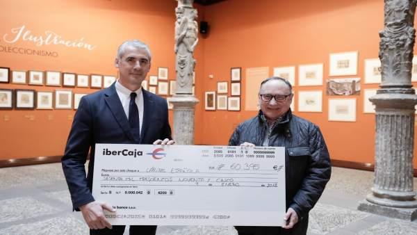 Entrega de Ibercaja a Cáritas del cheque de la recaudación de Navidad
