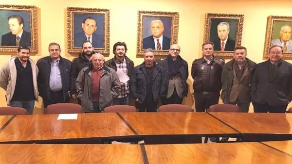 Representantes sindicales y patronales tras cerrar el preacuerdo