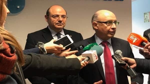 El ministro de Hacienda, Cristóbal Montoro, y el presidente del PP de Granada