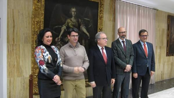 Pedro García y Antonio Díaz con representantes de CECO