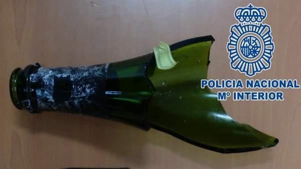 Botella rota utilizada en el atraco