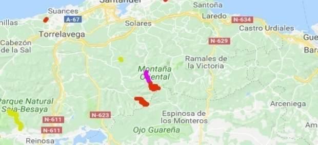 Tramos cortados en Cantabria (rojo) o con cadenas (rosa).