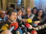 Jordi Sànchez, Carles Puigdemont y Quim Torra atendiendo a los medios.
