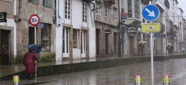 Temporal en Santiago, lluvia, temporal, paraguas, viento