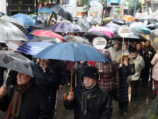 Protesta bajo la lluvia en Madrid