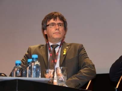 El expresidente de la Generalitat Carles Puigdemont en un debate en Ginebra