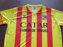Echan de Alimentaria a tres personas con camisetas con la bandera de Aragón y el lema 'Catar jamón de Teruel'