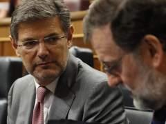 El ministro Catalá y el presidente Rajoy, este miércoles en el Congreso de los Diputados.