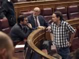 Alberto Garzón, coordinador federal de IU, y Pablo Iglesias, secretario general de Podemos.
