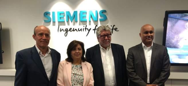 Bècle y García (Siemens España), Balmón (alcalde de Cornellà), Philip (Siemens).