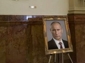 El retrato de Vladimir Putin junto al de Barack Obama en el Capitolio de Colorado