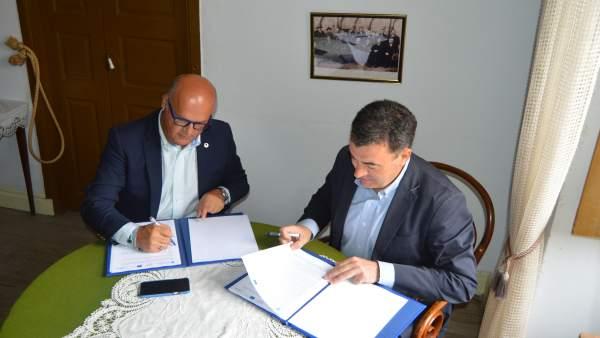 Román Rodríguez y José Manuel Baltar firman un convenio