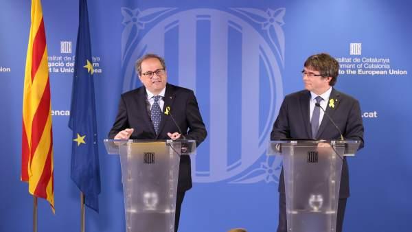 El presidente del Govern, Quim Torra, con el expresidente Carles Puigdemont