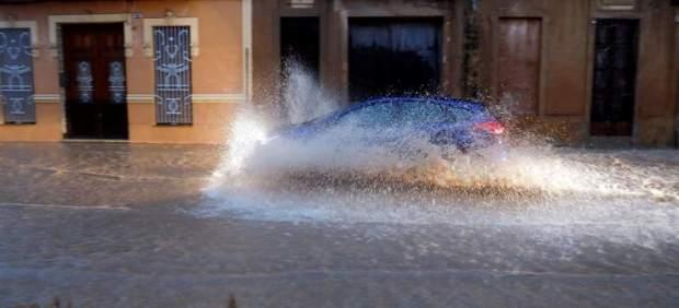 La semana arranca con bajada de temperaturas en toda España y alerta roja por lluvias en Alicante ...